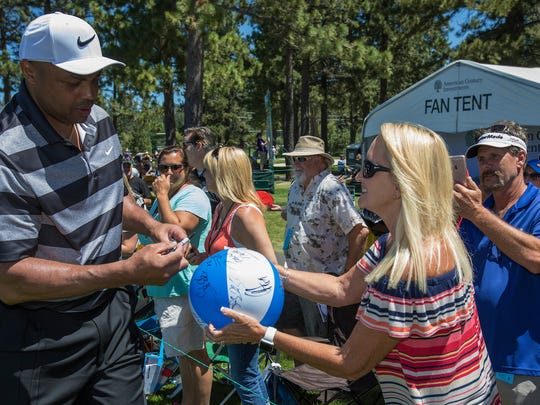Charles Barkley signs autographs for fans during the American Century Championship at Edgewood Tahoe Golf Course in Stateline, Nevada, Sunday, July 16, 2017.