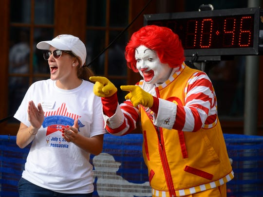 Ronald McDonald cheers on runners during the Ronald