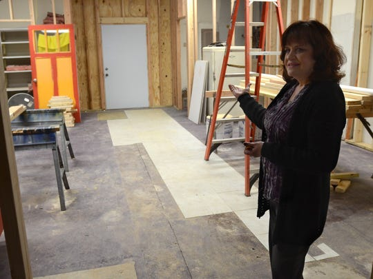 Branch Manager, Nancy Godinez, talks about the expansion progress Monday, Dec 29, at the Capac Public Library.