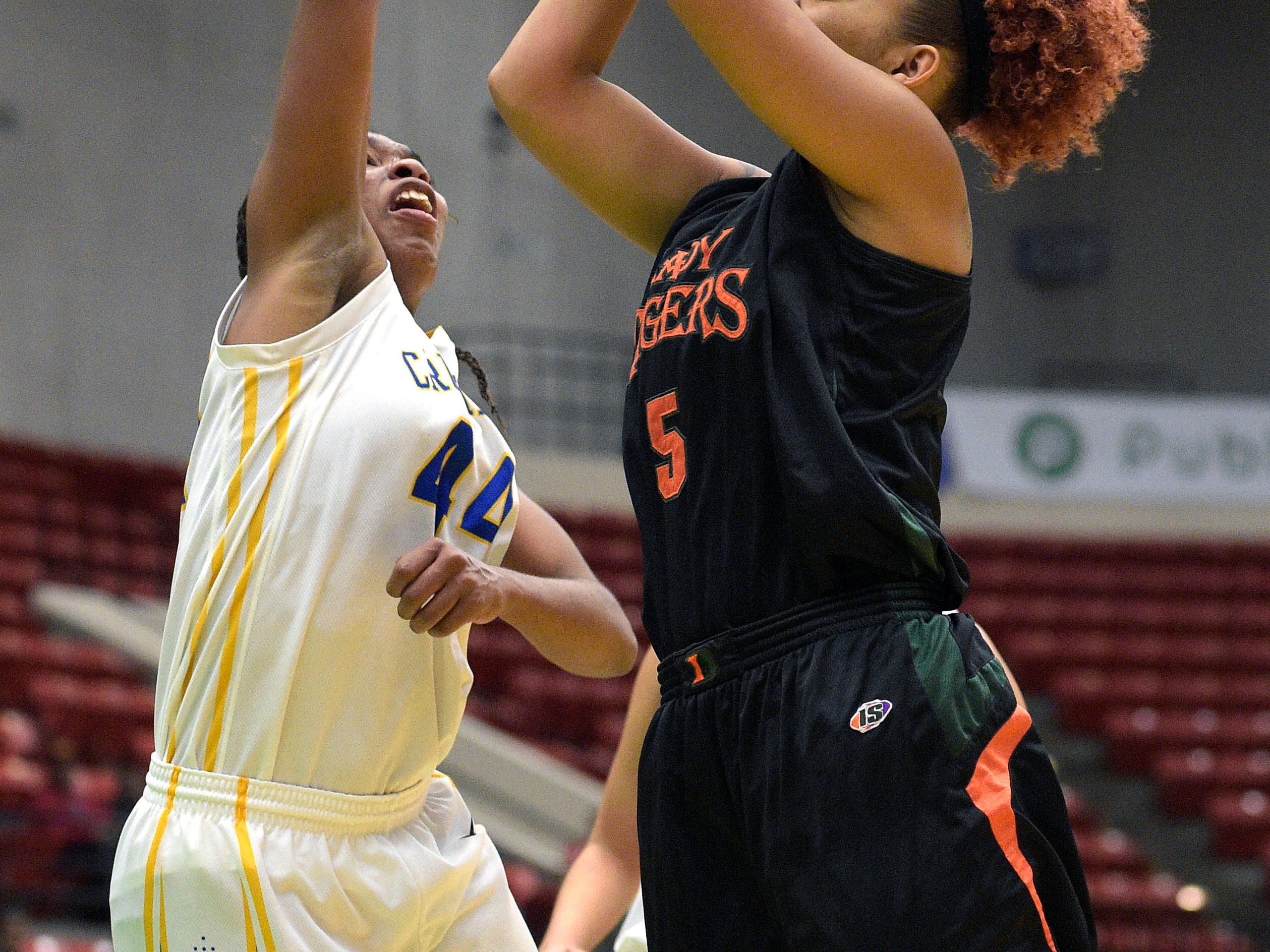 Dunbar's Alicia Johnson (5) puts up a shot in front of Cardinal Newman's Tytionia Adderly (44) during a girls basketball game at the FHSAA State Finals, Tuesday, Feb. 17, 2015, in Lakeland, Fla.(Photo/Phelan M. Ebenhack)