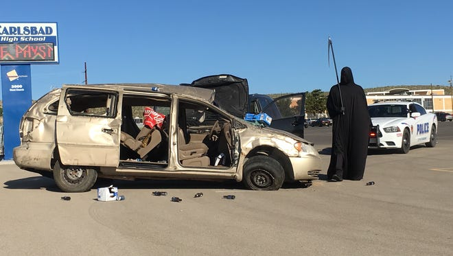 Carlsbad Police Department's Community Service Department staged a scene of an accident to remind students to avoid drinking and driving.