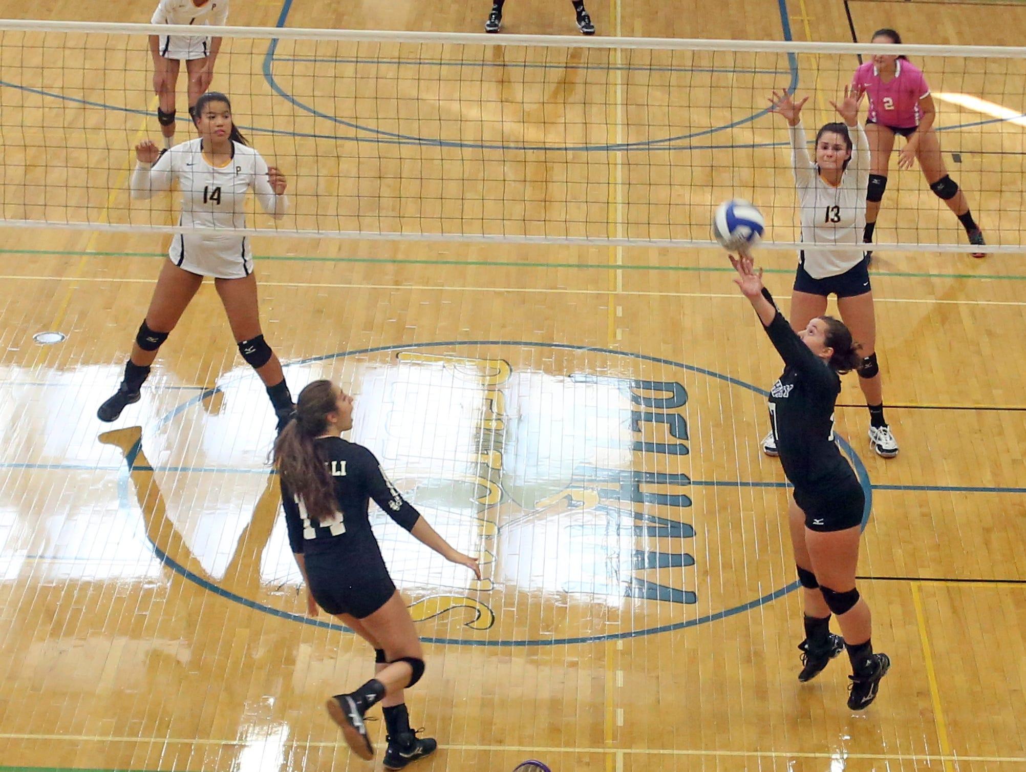 John Jay's Amanda Wien sets up a shot for Rachel Cifarelli during a varsity volleyball match against Pelham at Pelham High School Sept. 3, 2015.