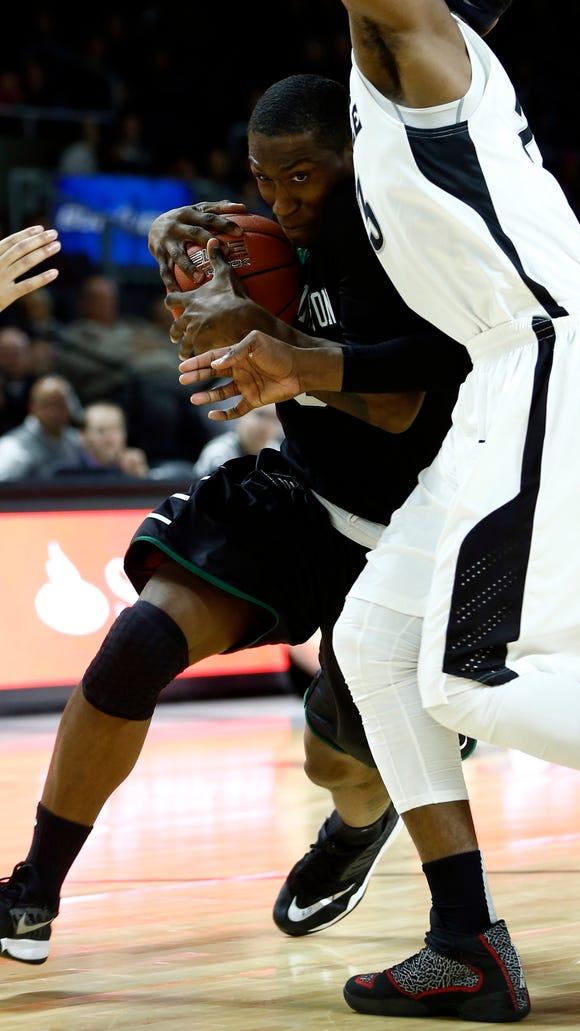 Binghamton's Jordan Reed drives to the basket against