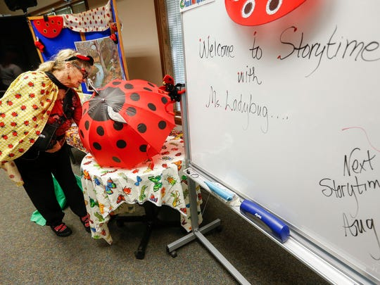 Joyce Tolliver gets ready to start Storytime with Ms. Ladybug at the Springfield Conservation Nature Center on Wednesday, May 9, 2018. Tolliver is celebrating her 15th year as Ms. Ladybug.