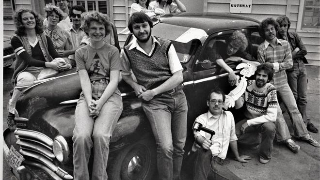 """""""The guy who writes about moving pictures was moved by the pictures of his life,"""" writes Ledger film critic Al Alexander, kneeling fourth from left, with the staff of The Gateway, his college newspaper."""