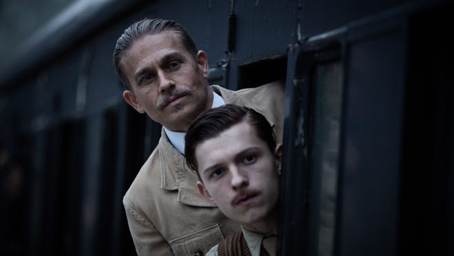 "Percy (Charlie Hunnam, top) and Jack (Tom Holland) are father and son in ""The Lost City of Z."""
