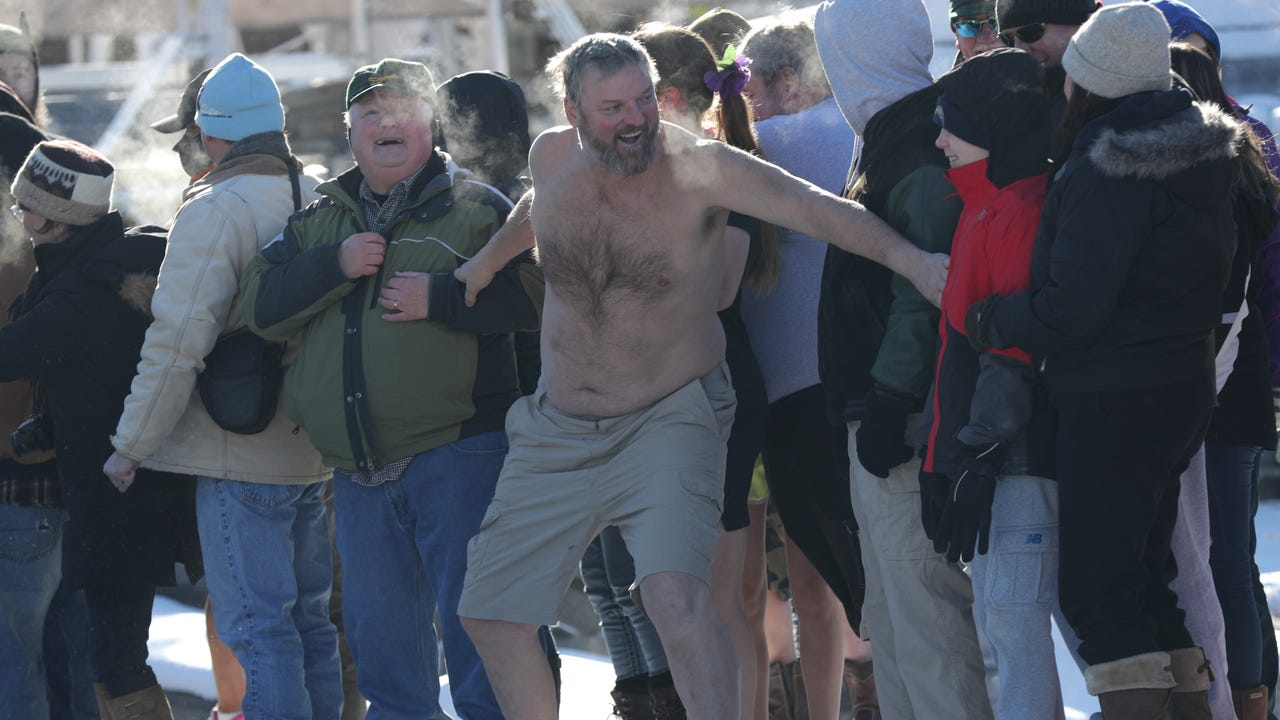 The annual Waupaca Chain 'O Lakes Polar Bear Plunge was held at the Becker Marine dock as more than 100 onlookers cheered on the participants.
