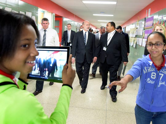 """Goode News Crew"" member Aaliyah Ushry, left, backpedals as she records Governor Tom Wolf's visit to Goode K-8 with co-member Ni'lee Mariche, both sixth-graders, Thursday, Feb. 18, 2016. Wolf, left center, talks with York City School Superintenent Dr. Eric Holmes while touring the school. Bill Kalina photo"