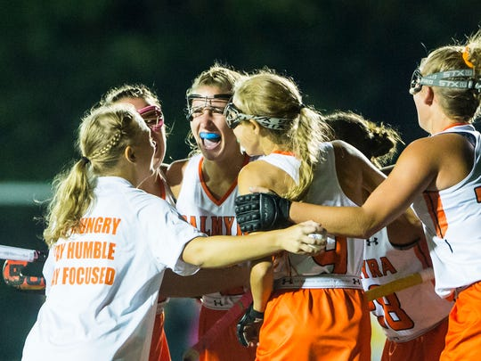 Palmyra's Jess Dembrowski (center) is surrounded by