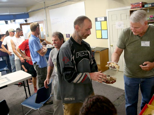 Volunteer Mark Rambo of Silverdale hands out slices