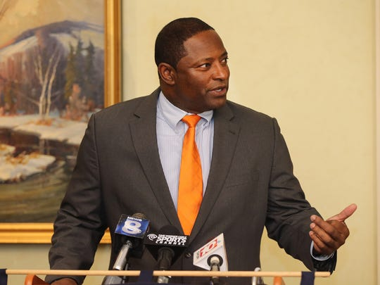 Syracuse head football  coach Dino Babers speaks with the media during a stop at Monroe Golf Club during an alumni event.