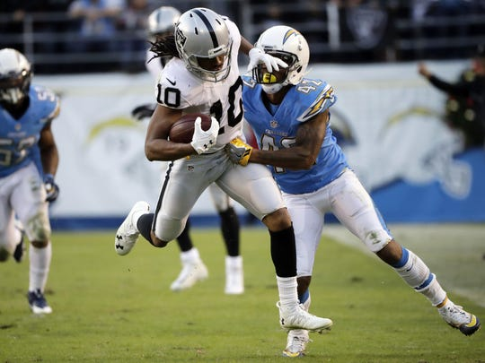 Oakland Raiders wide receiver Seth Roberts moves past San Diego Chargers cornerback Trevor Williams during the second half of a game on Dec. 18, 2016 in San Diego, Calif.