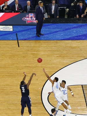 Kris Jenkins launches the game-winner as Jay Wright watches.