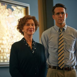 Helen Mirren, left, and Ryan Reynolds, in a scene from the film, Woman in Gold.