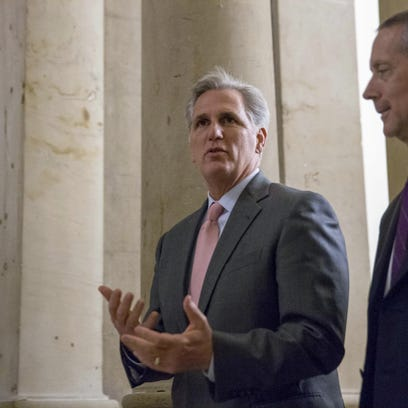 In this Sept. 30, photo, House Majority Leader Kevin McCarthy of Calif., left, walks on Capitol Hill in Washington. McCarthy says he regrets comments suggesting the House special committee on Benghazi has political goals. McCarthy says he never intended to make that suggestion. He says the purpose of the committee is to find out the truth and it has nothing to do with politics.