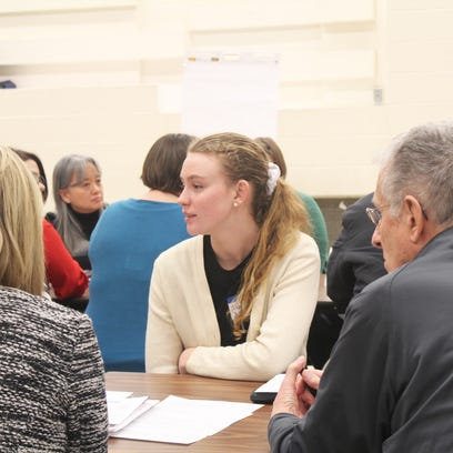 City High student Lucy Wagner talks with a task force looking into the ICCSD's bell schedule on Jan. 25, 2016.