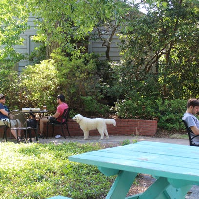 The newly renovated patio at Vintage Wine & Spirits provides a comfortable living space atmosphere.