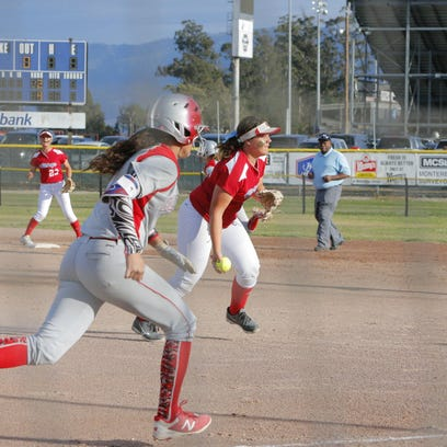 North Salinas' Micaela Leal throws the ball to first base as Hollister's Callee Heen runs there during the second inning Tuesday.
