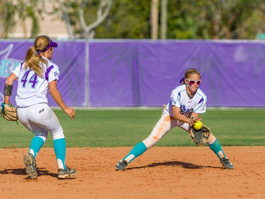 Defense is a big reason for FSW's annual success. Here sophomore Riley Russell, an All-Suncoast Conference first-teamer, scoops the ball in.