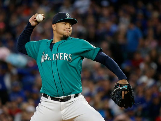FILE - In this Sept. 19, 2016, file photo, Seattle Mariners starting pitcher Taijuan Walker throws against the Toronto Blue Jays in a baseball game in Seattle. Seattle and Arizona pulled off a five-player trade Wednesday night, Nov. 23, with the Mariners acquiring speedy infielder Jean Segura and the Diamondbacks getting right-hander Walker as the centerpieces of the deal. (AP Photo/Ted S. Warren, File)