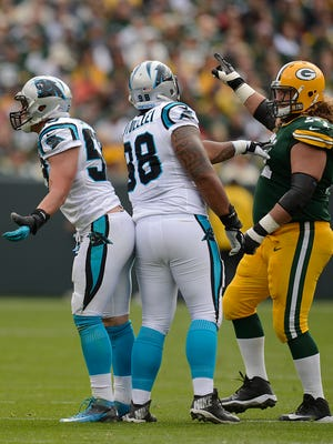 Panthers linebacker Luke Kuechly (59) reacts after getting ejected during a 2014 game at Lambeau Field.
