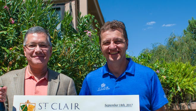 Florent Lescombes of St. Clair Winery presented a check to Wally Verdooren, Roadrunner Food Bank's Chief Development Officer.