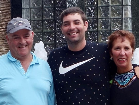 Bobby Reiss, who died from an opioid overdose in 2017, with his parents Robert and Eleanor Reiss.