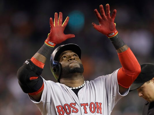Boston Red Sox designated hitter David Ortiz looks up as he crosses home plate after his three-run home run during the ninth inning off Detroit Tigers relief pitcher Joba Chamberlain in a baseball game in Detroit, Sunday, June 8, 2014. (AP Photo/Carlos Osorio)