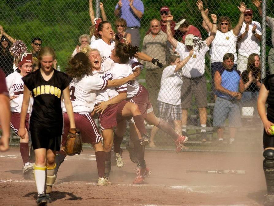Members of the 2008 Lyndon softball team celebrate the Division II softball state championship.