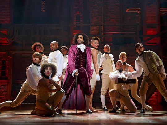 Daveed Dggs, as Thomas Jefferson, performs with company