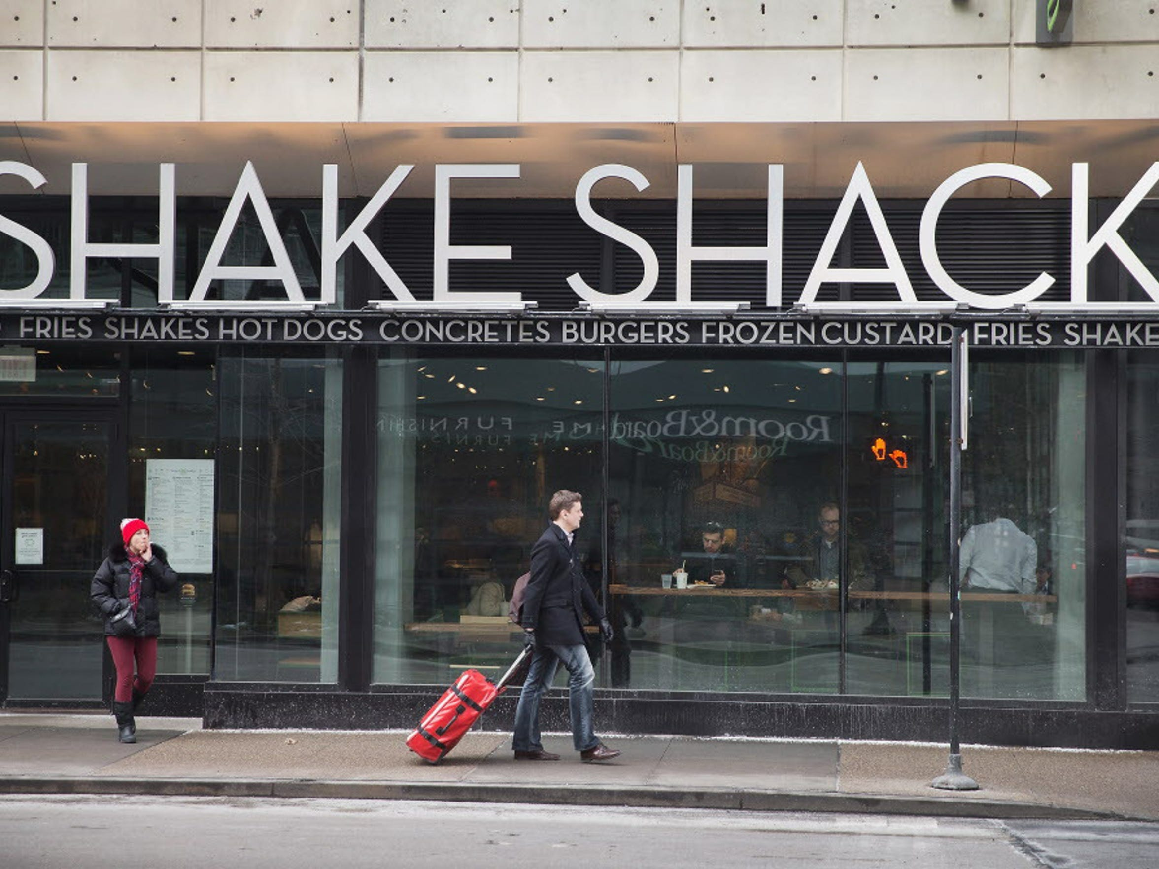 A sign hangs over the entrance of a Shake Shack restaurant in Chicago, Illinois.