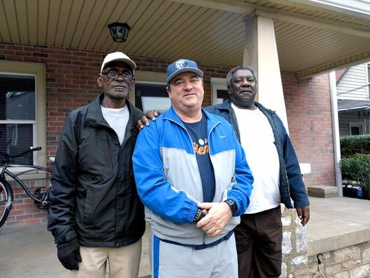 Dwayne McCord,left, Kevin Riggs and Joe Rucker stand