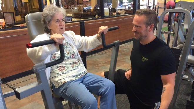 Irene Mondou of Poughkeepsie works out with Cameron Steer, a personal trainer with Gold's Gym Dutchess County in LaGrange. Mondou, 79, makes regular exercise a part of her ongoing routine.