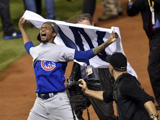 Chicago Cubs relief pitcher Carl Edwards (6) celebrates