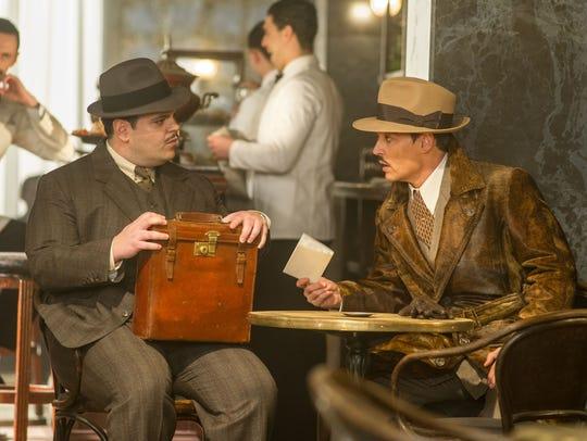 Josh Gad (left) plays the personal secretary of Johnny