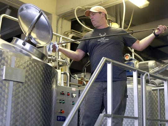 Head brewer Joe Karls produces Hinterland Brewery's final brew at its Dousman Street brewery in downtown Green Bay. The business will move later this year to its new brewery and restaurant in the Green Bay Packers' Titletown District across the street from Lambeau Field.
