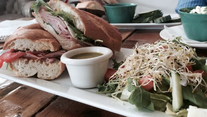 The H&M sandwich at Craft & Social, 305 E. Franklin, includes Black Forest Ham and Manchego cheese. It is served with a side Craft Salad. The H&M sandwich at Craft & Social, 305 E. Franklin, includes Black Forest Ham and Manchego cheese. It is served with a side Craft Salad.