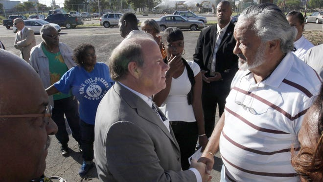 Detroit Mayor Mike Duggan talks to Brush Park CDC member Warner McBryde after Duggan announced that the city is seeking proposals to redevelop the historic Brewster Wheeler Recreation Center on Thursday, Aug. 28, 2014.