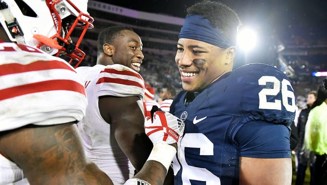 Penn State's Saquon Barkley greets Nebraska players after an NCAA Division I football game Saturday, Nov. 18, 2017, at Beaver Stadium. Penn State defeated Nebraska 56-44 in its final home game of the 2017 season.