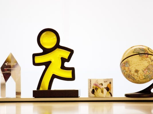 This May 12, 2008 file photo shows the AOL Running Man logo and other decorations at AOL's New York offices.
