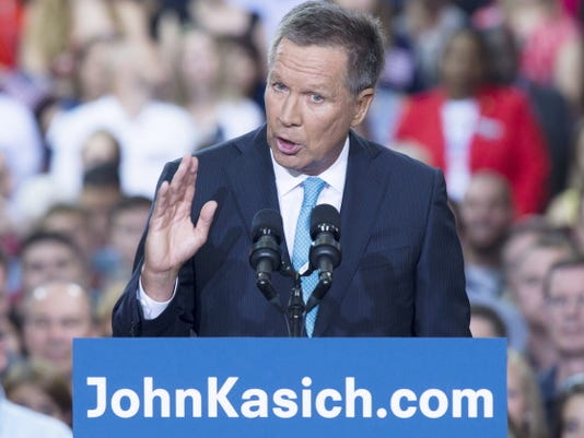Ohio Gov. John Kasich announces he is running for the 2016 Republican party's nomination for president during a campaign rally Tuesday at Ohio State University, in Columbus, Ohio.