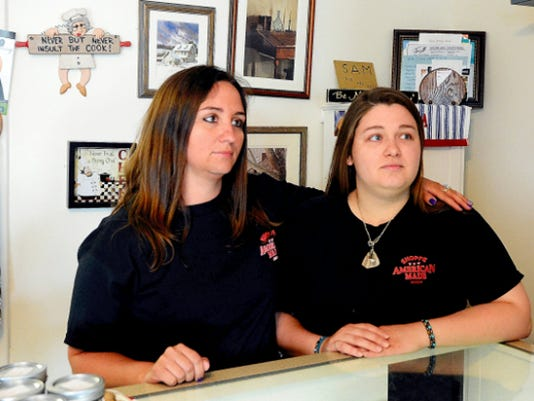 Barb Schrum's daughters, Alecia Armold (left) and Becky Schrum (right) said they will open their slain mother's store one last time on Saturday, Nov. 7, 2015.