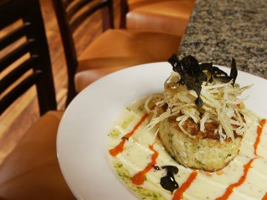Chef creations at Peterson's in Fishers has included a jumbo lump crab cake with mustard sauce and fried leeks.