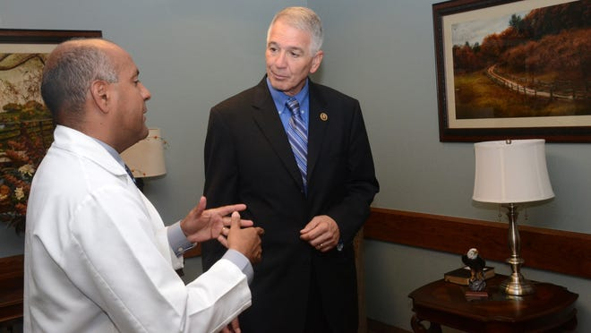 Dr. Jose' Rivera (left) tells U.S. Rep. Ralph Abraham about the serenity room located in the main hospital at the VA Medical Center in Pineville.