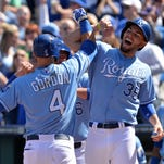 Kansas City left fielder Alex Gordon celebrates with teammate Eric Hosmer (35) after hitting a three-run home run against the Tampa Bay Rays in the fifth inning at Kauffman Stadium on Wednesday.