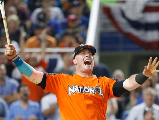 Miami Marlins' Justin Bour reacts as he competes during
