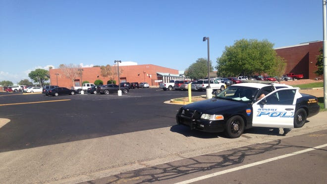 Westview High School was secured while police searched the campus for a student seen wearing a holster.