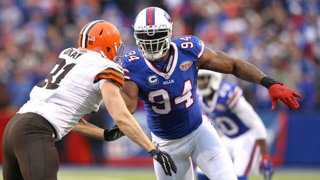 Bills Mario Williams looks to beat the block of Cleveland's Jim Dray (81) during Sunday's game at Orchard Park.