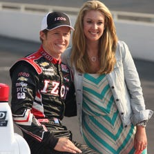 FILE -- Indianapolis 500 pole sitter Ryan Briscoe and wife Nicole posing for photographs May 20, 2012 at The Indianapolis Motor Speedway.