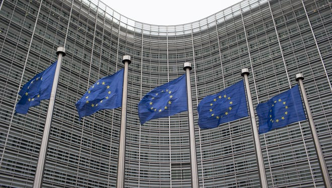 European Union (EU) flags fly outside the European Council building in Brussels, Belgium, on Tuesday, Nov. 24, 2015.